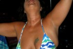 Free porn pics of Chubby milf shows off new bikinis on patio bar. 1 of 143 pics